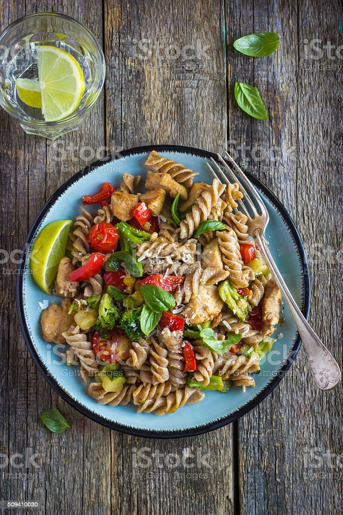 Whole wheat pasta  with chicken and vegetables stock photo