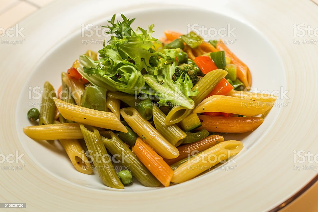 Whole wheat pasta  with vegetables on cast stock photo