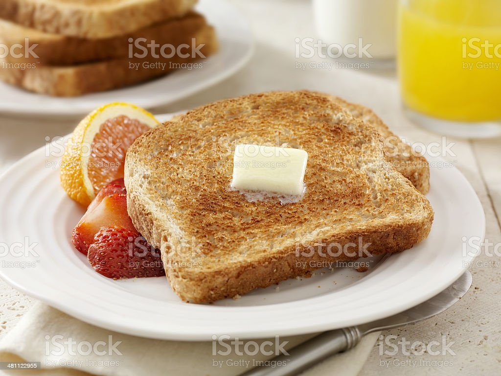 Whole Wheat Toast with Melting Butter stock photo