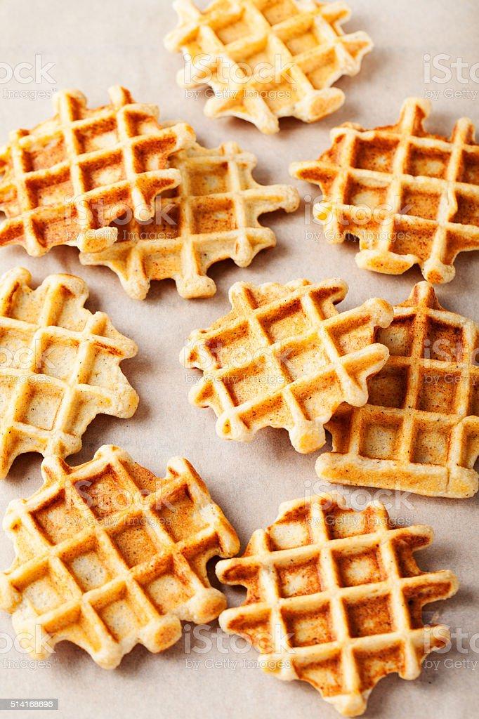 Wholegrain belgian waffles on paper background stock photo