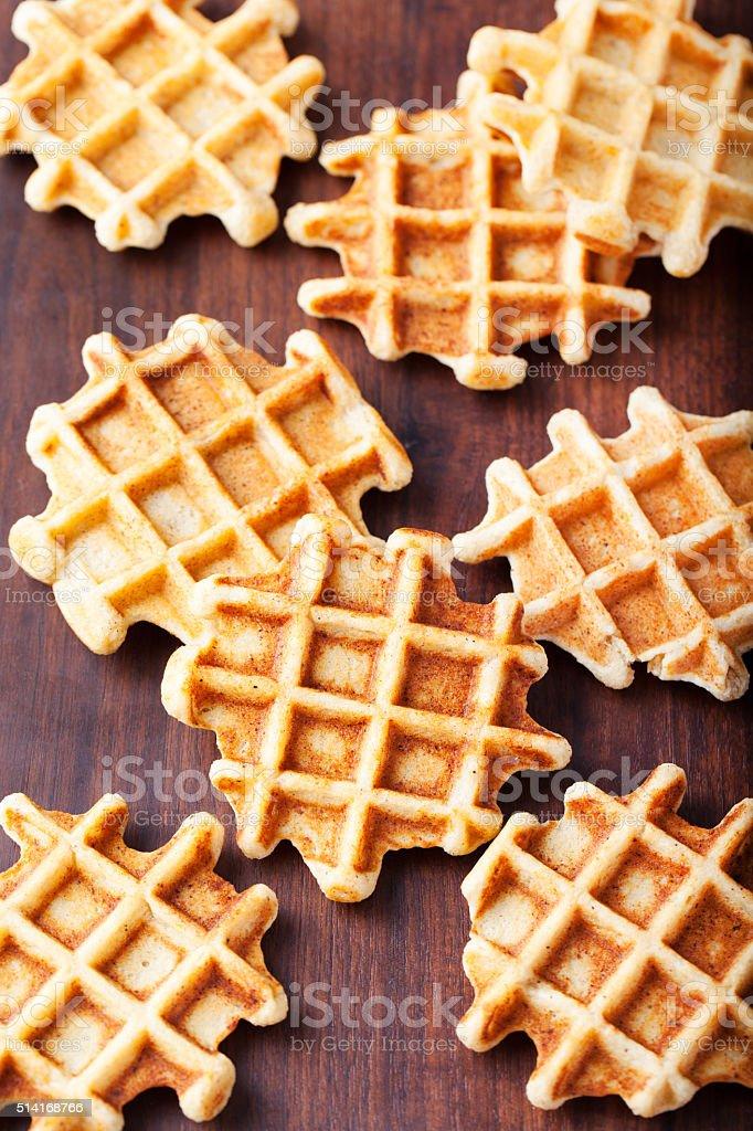 Wholegrain belgian waffles on wooden background stock photo