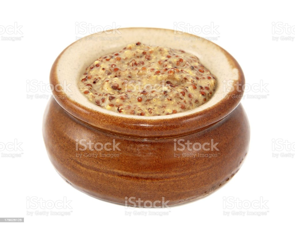 Wholegrain mustard served in a small ceramic pot royalty-free stock photo