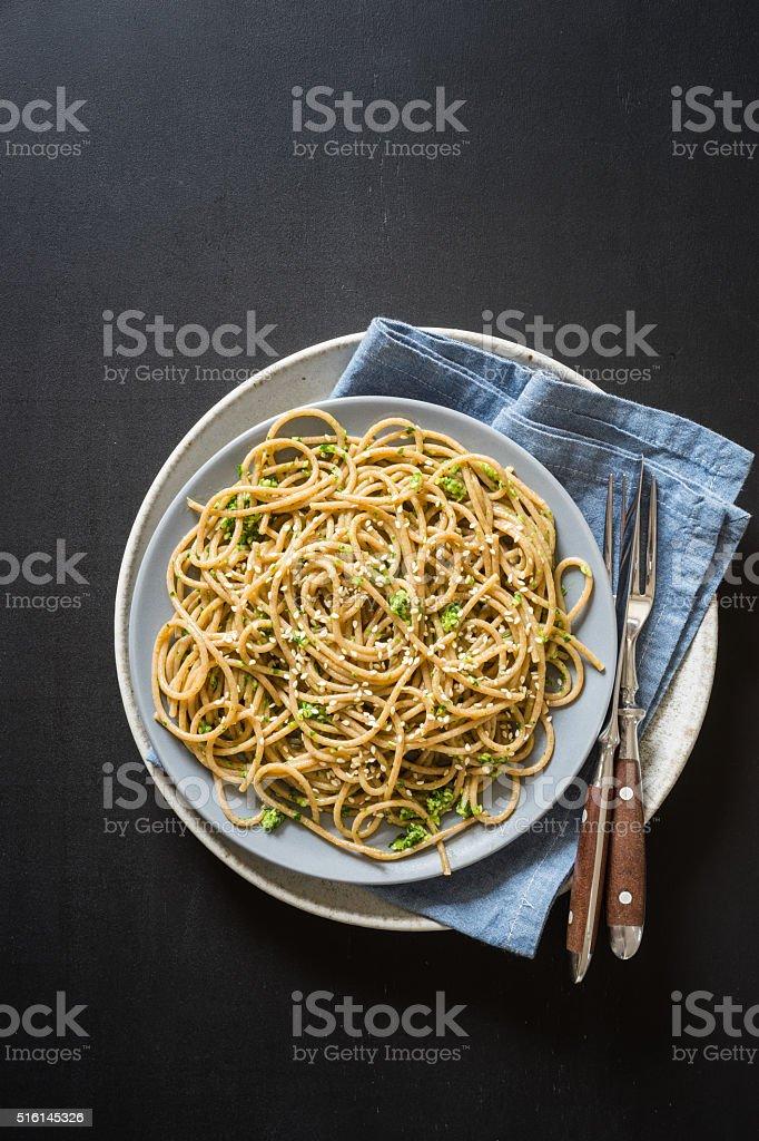 Wholegrain spaghetti with wild garlic and sesame seeds pesto sauce stock photo