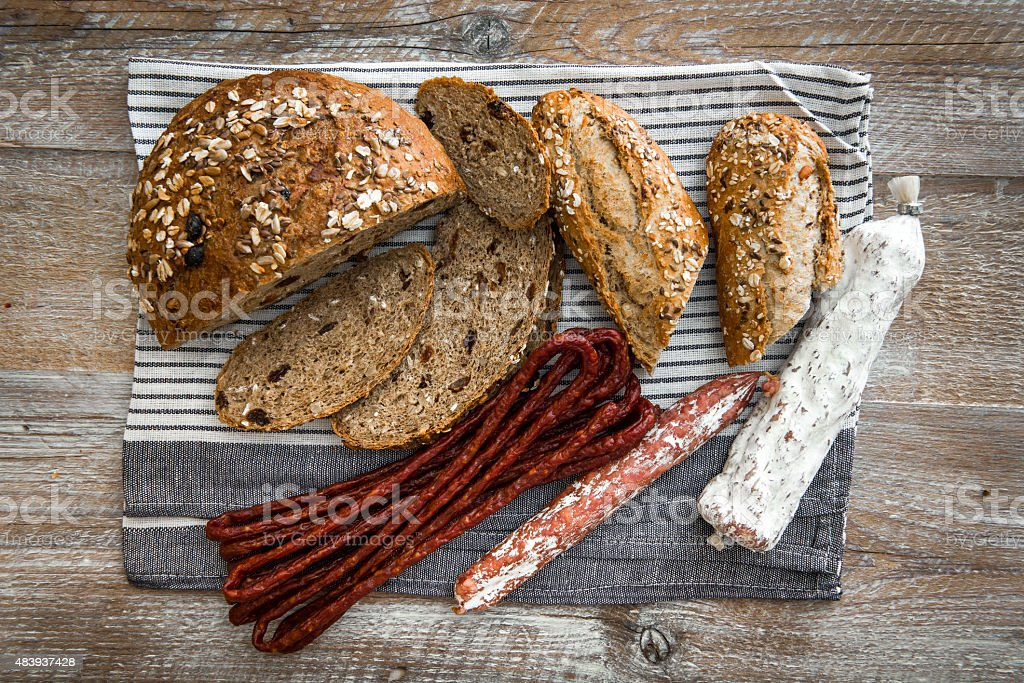 Wholemeal bread with dried sausages stock photo