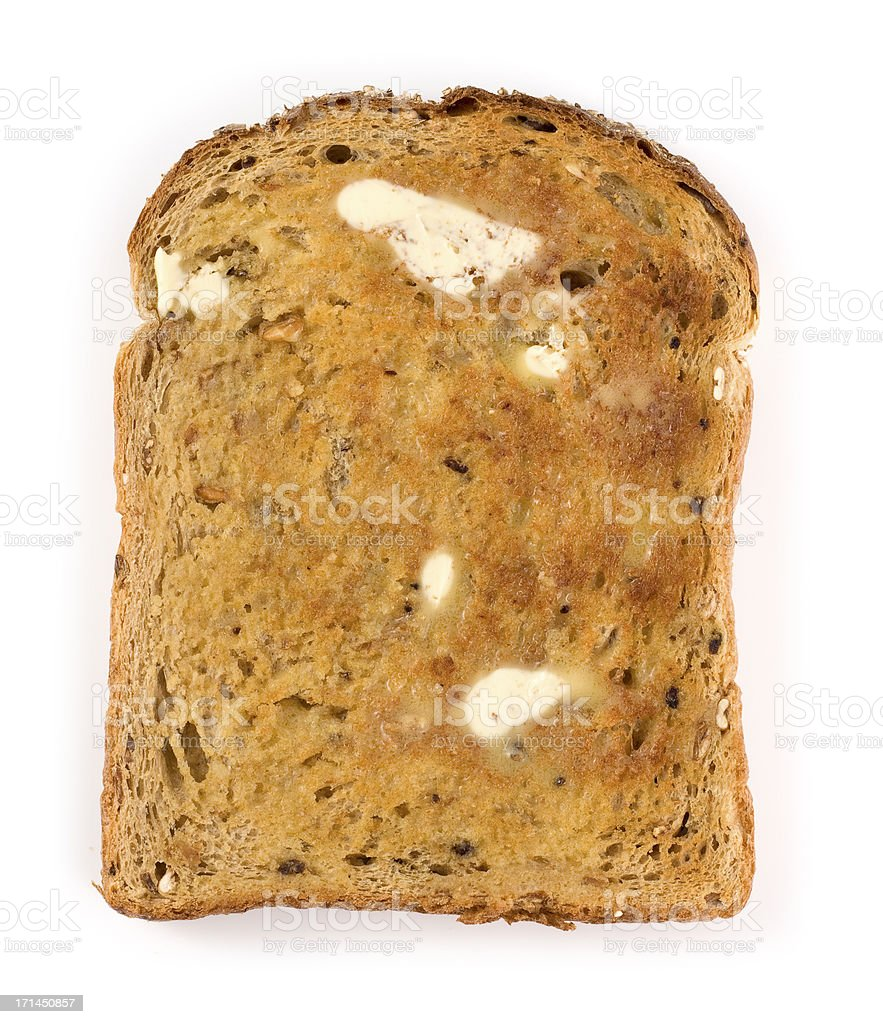 Wholemeal brown toast with butter on a white background stock photo