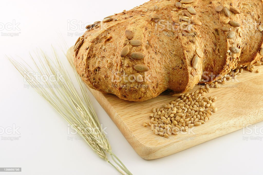 Wholemeal Loaf of Bread with wheat plants and seeds 2 royalty-free stock photo