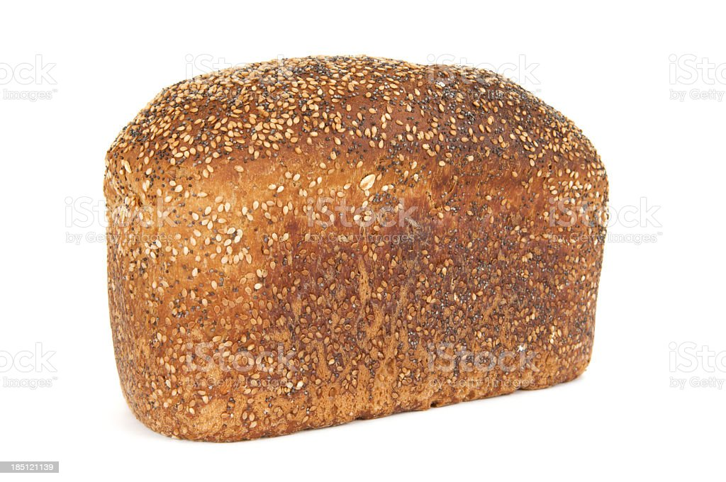 Wholemeal multiseeded loaf of brown bread on a white background stock photo