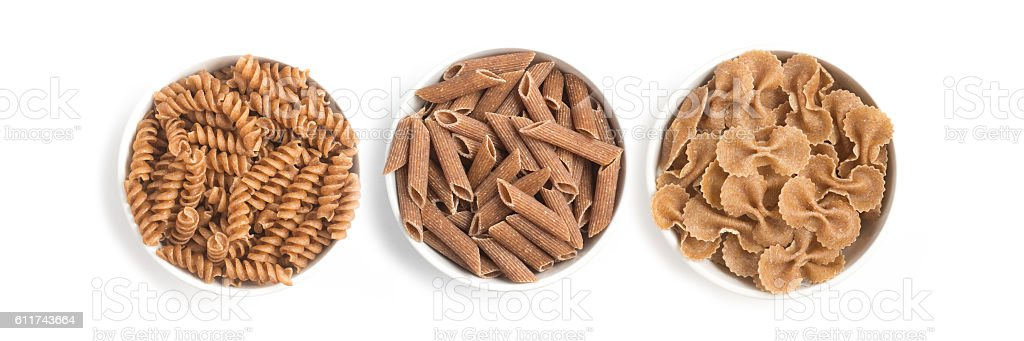 Wholemeal Pasta. Penne and Fusilli stock photo