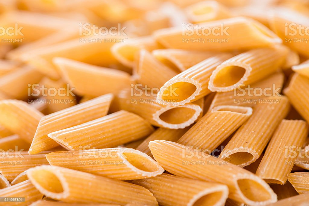Wholemeal Penne Background stock photo