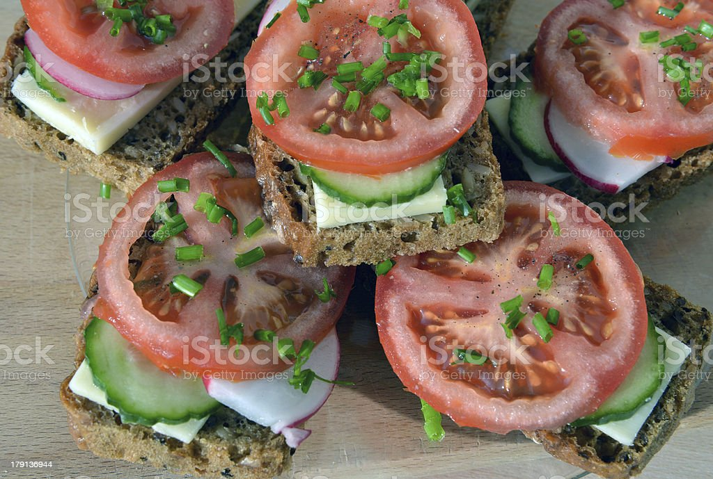 Wholemeal rye bread sandwich with tomato, cucumber, radish and c royalty-free stock photo