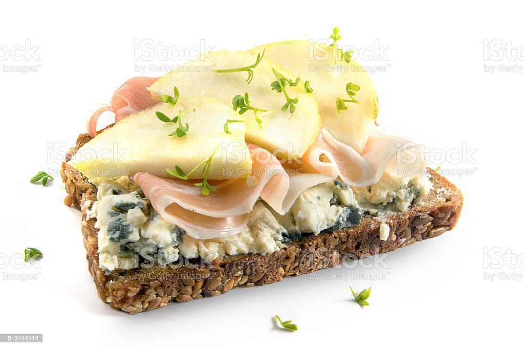 wholemeal sandwich with blue cheese, ham and apple on white stock photo
