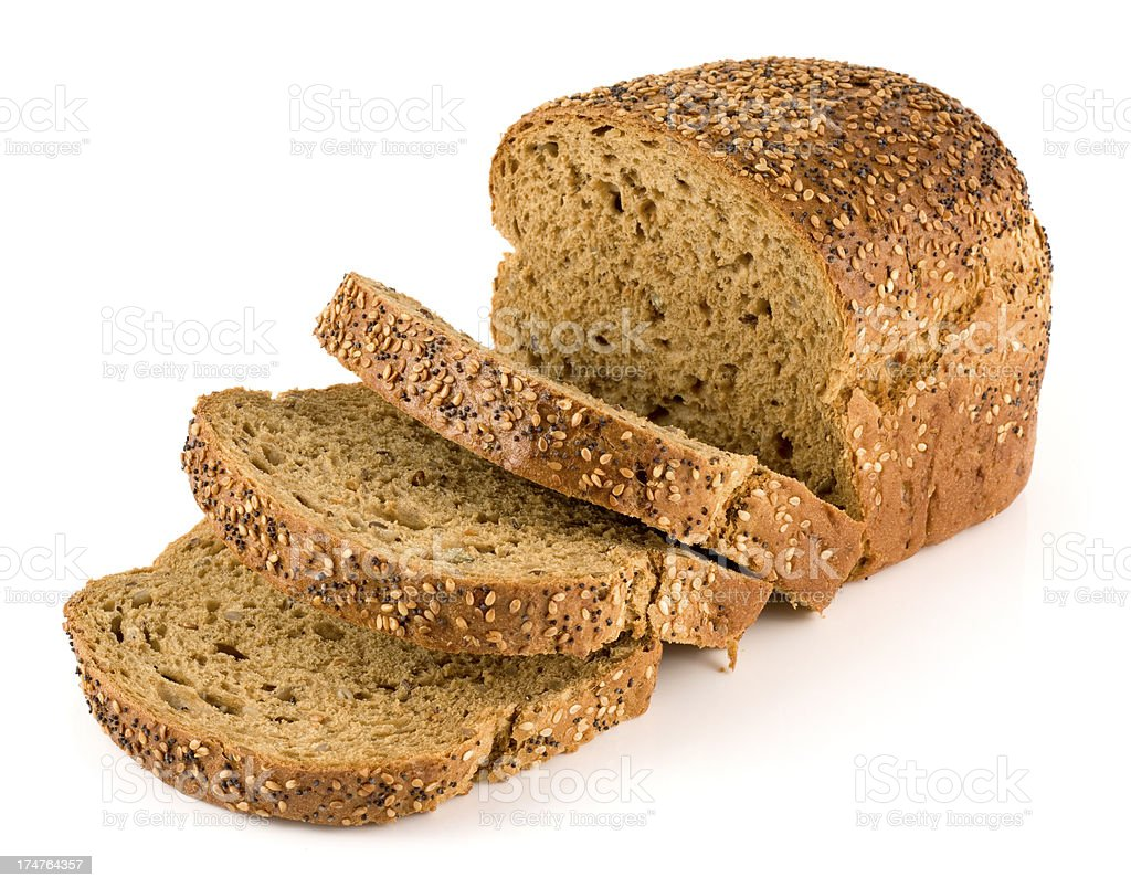 Wholemeal seeded brown bread on a white background stock photo