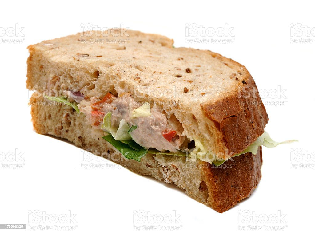 Wholemeal tuna mayonnaise sandwich sliced isolated against white royalty-free stock photo