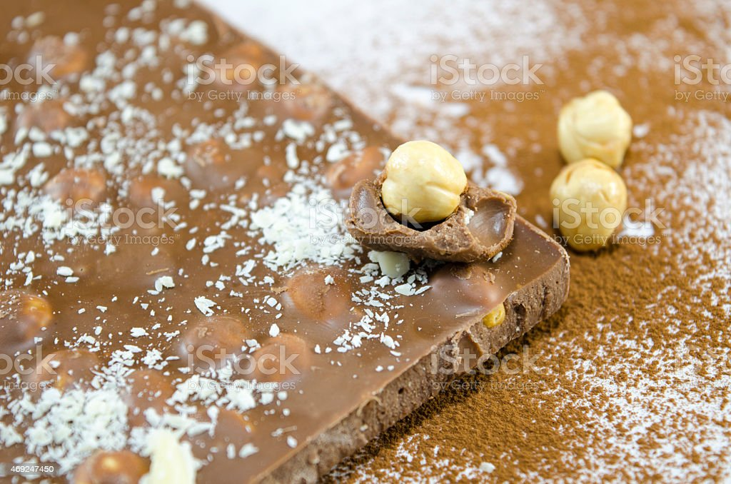 Wholenuts chocolate on a table sprayed with cocoa stock photo