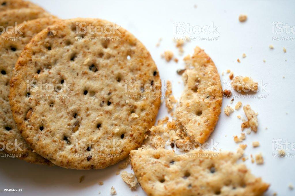 Wholewheat crackers on white background stock photo