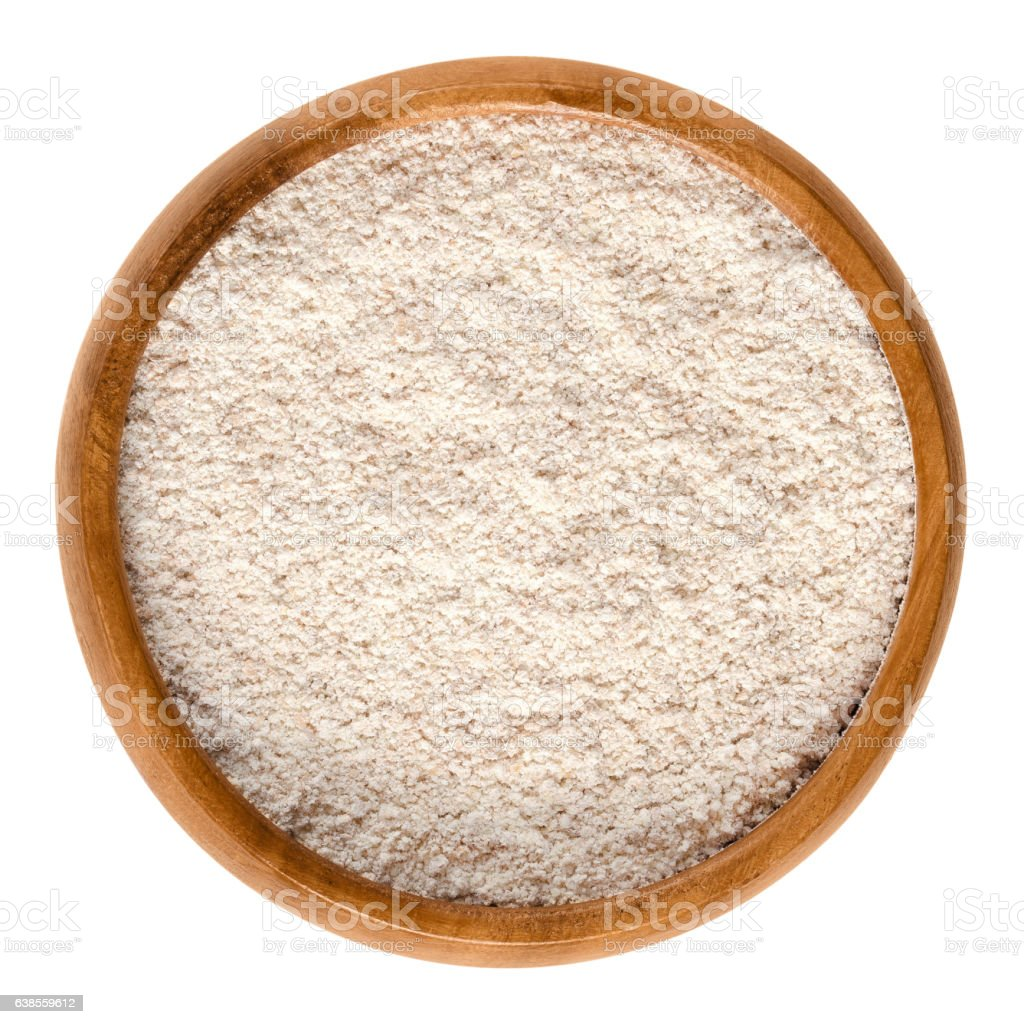 Whole-wheat flour, wholemeal flour in wooden bowl stock photo