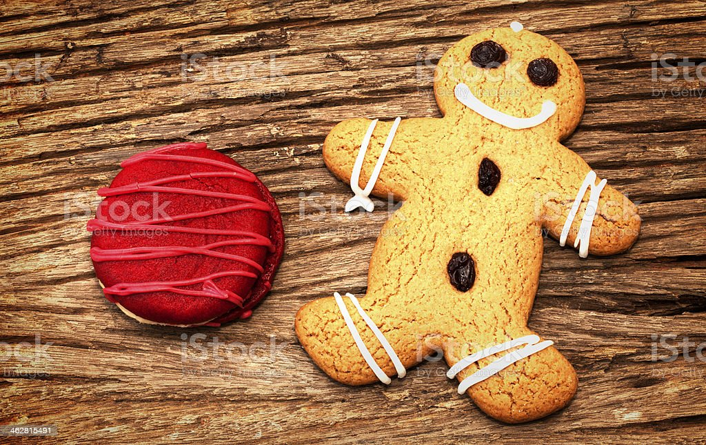 Whoopie pie and ginger bread on the wood background stock photo