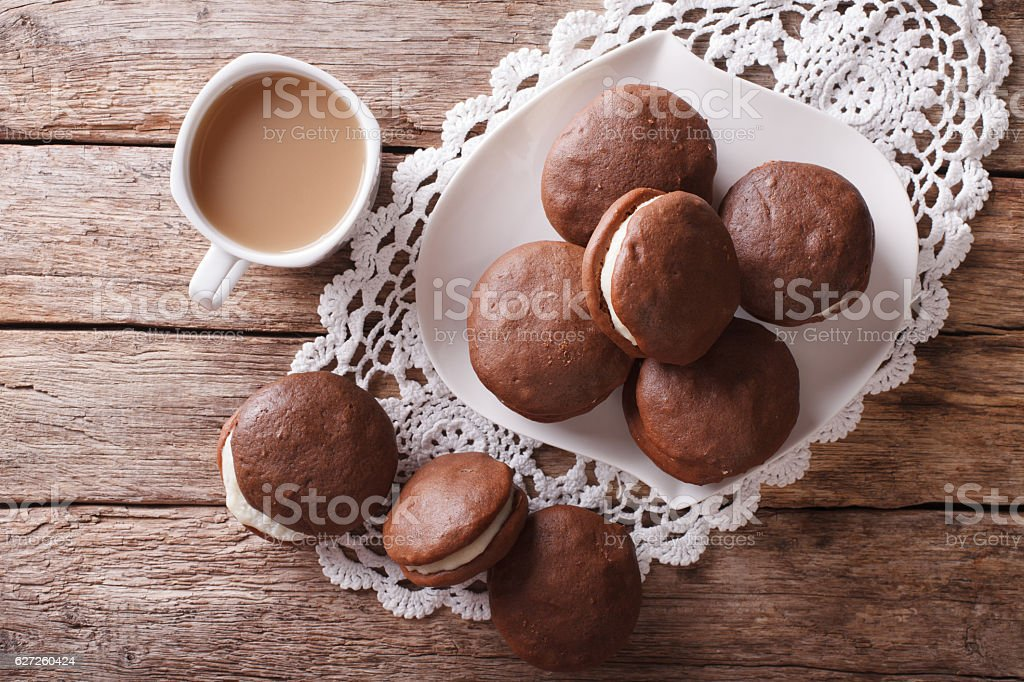 Whoopie pie dessert and coffee on table. Horizontal top view stock photo