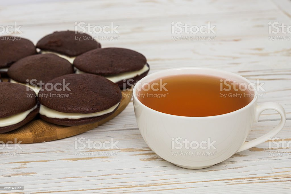 Whoopie pies and a cup of tea stock photo