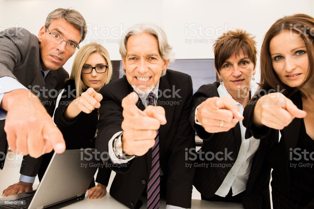 Who`s to Blame? Business People Pointing Finger in Conference Room stock photo