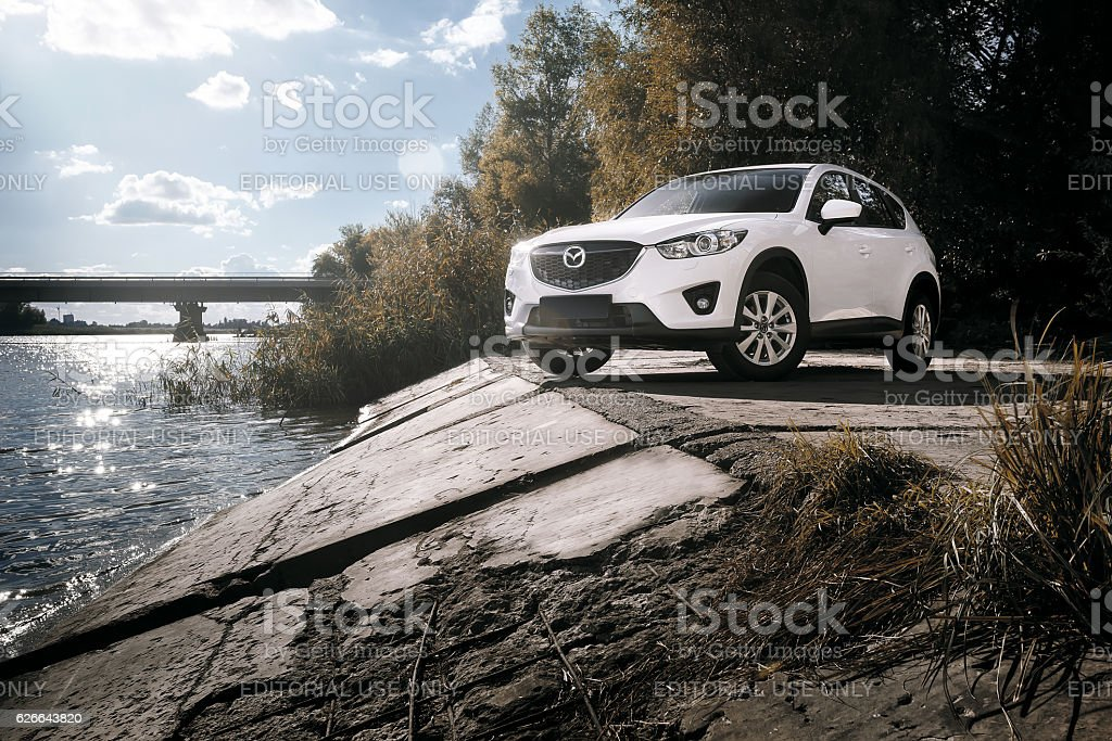 Whtie car Mazda CX-5 is parked at countryside stock photo