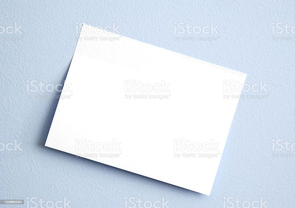 Whtie sticky note on blue wall royalty-free stock photo