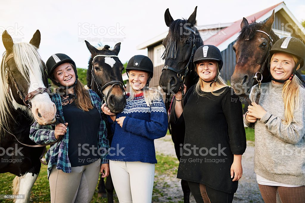 Why horse riding? It's cheaper than therapy. stock photo