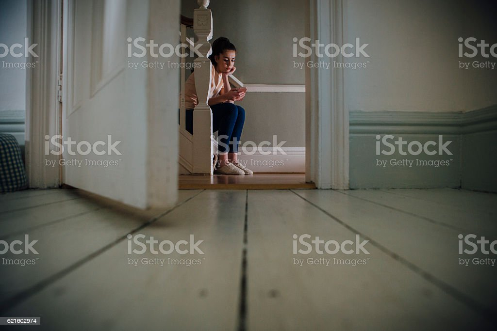 Why is he not texting me back? stock photo