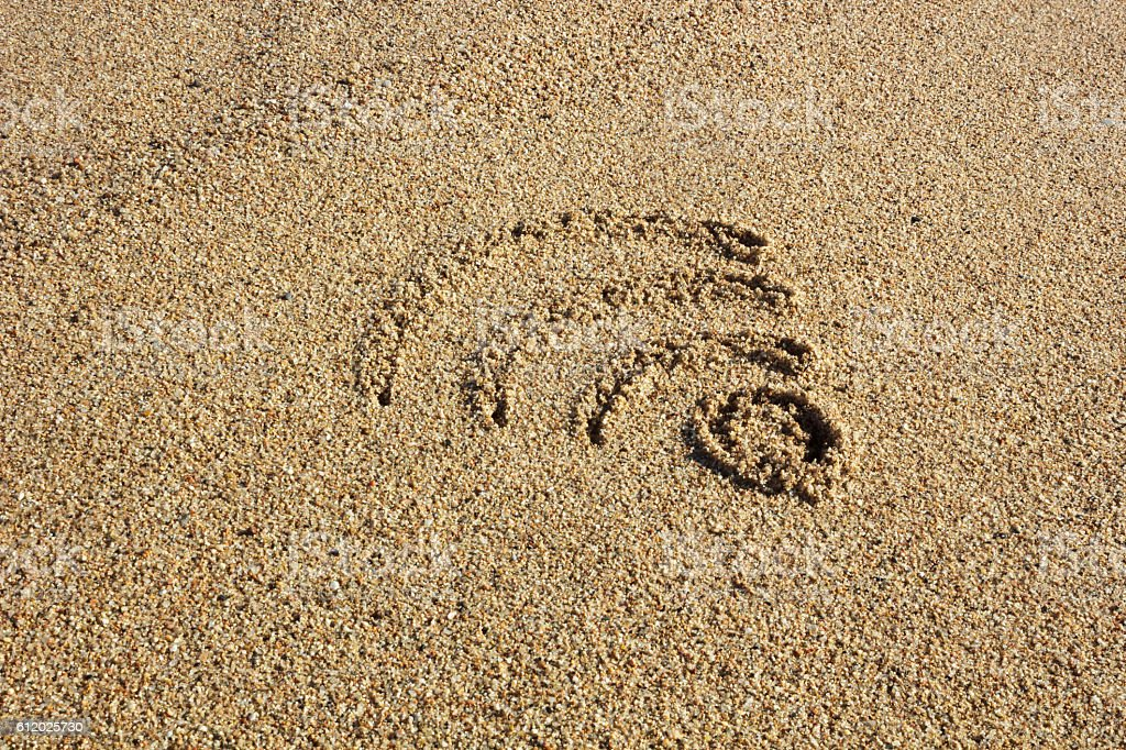 Wi fi sign drawn in the sand stock photo
