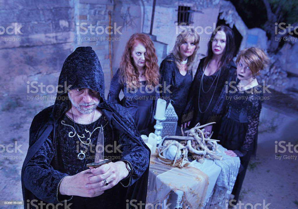 Wicca Priest and Coven in Ritual stock photo