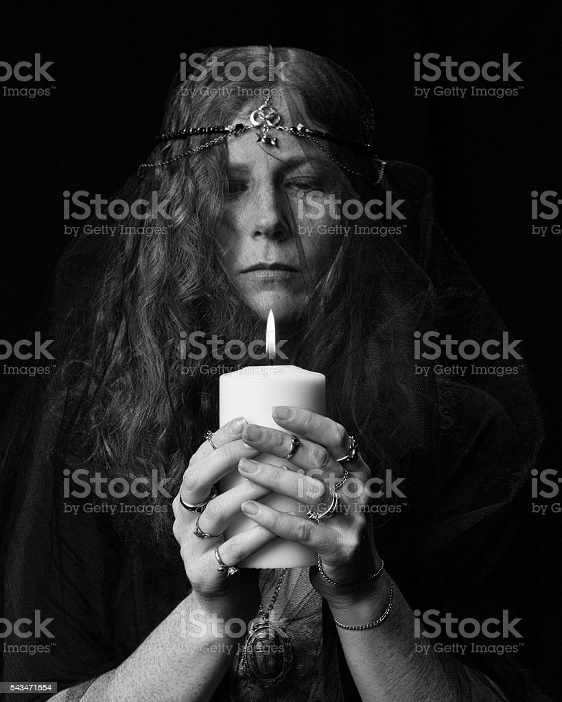 Wiccan Woman With Candle stock photo