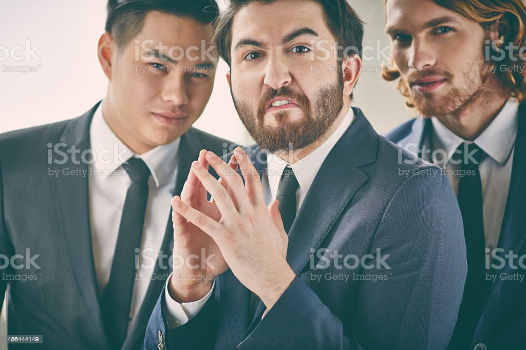 Wicked businessman stock photo