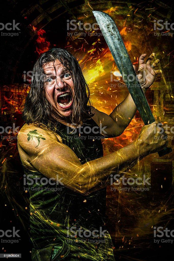 wicked man with machete stock photo