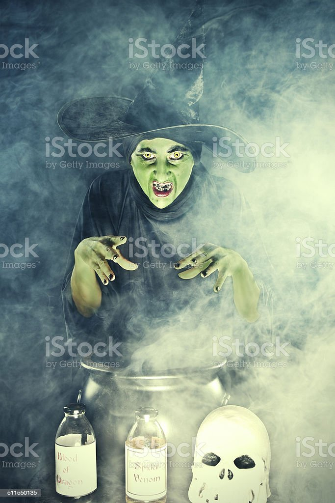 Wicked Witch Casting Spell Over Cauldron stock photo