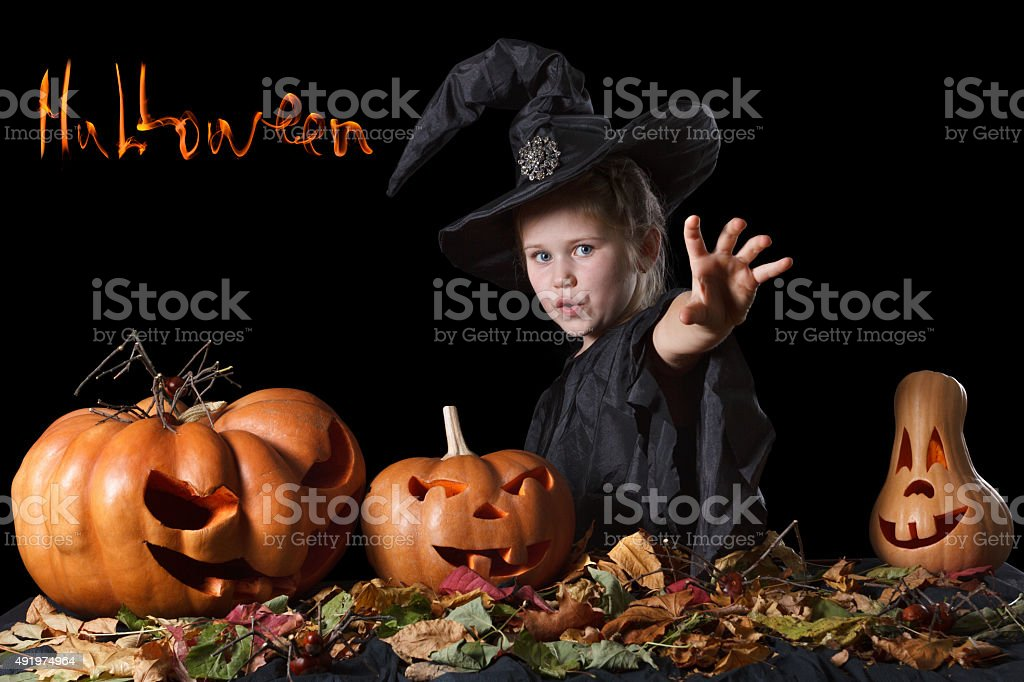 Wicked witch casts a spell and sends the curse. Halloween stock photo
