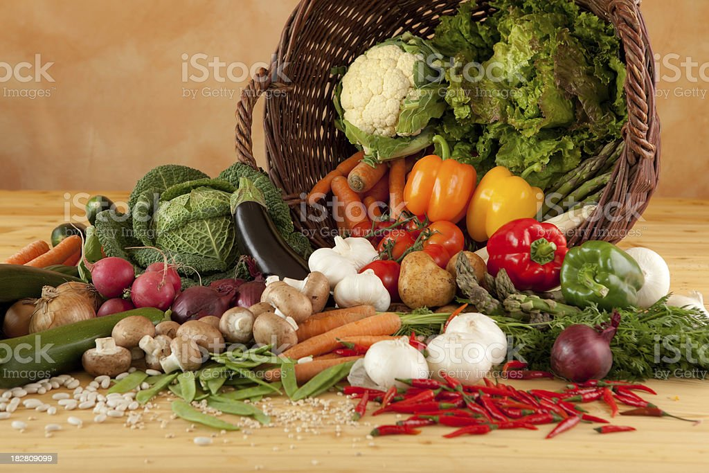 wicker basket full of healthy vegetables royalty-free stock photo