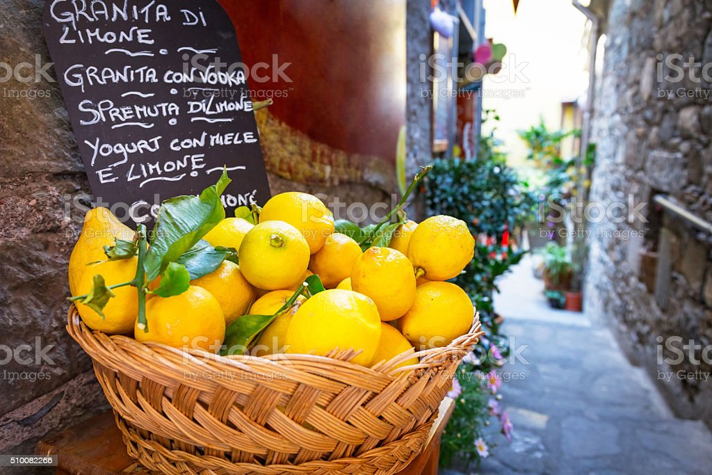 Wicker basket full of lemons on the italian street stock photo