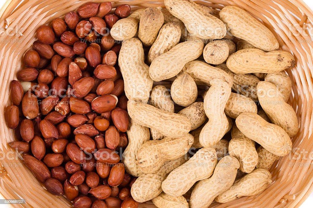 Wicker basket full of peanuts. stock photo
