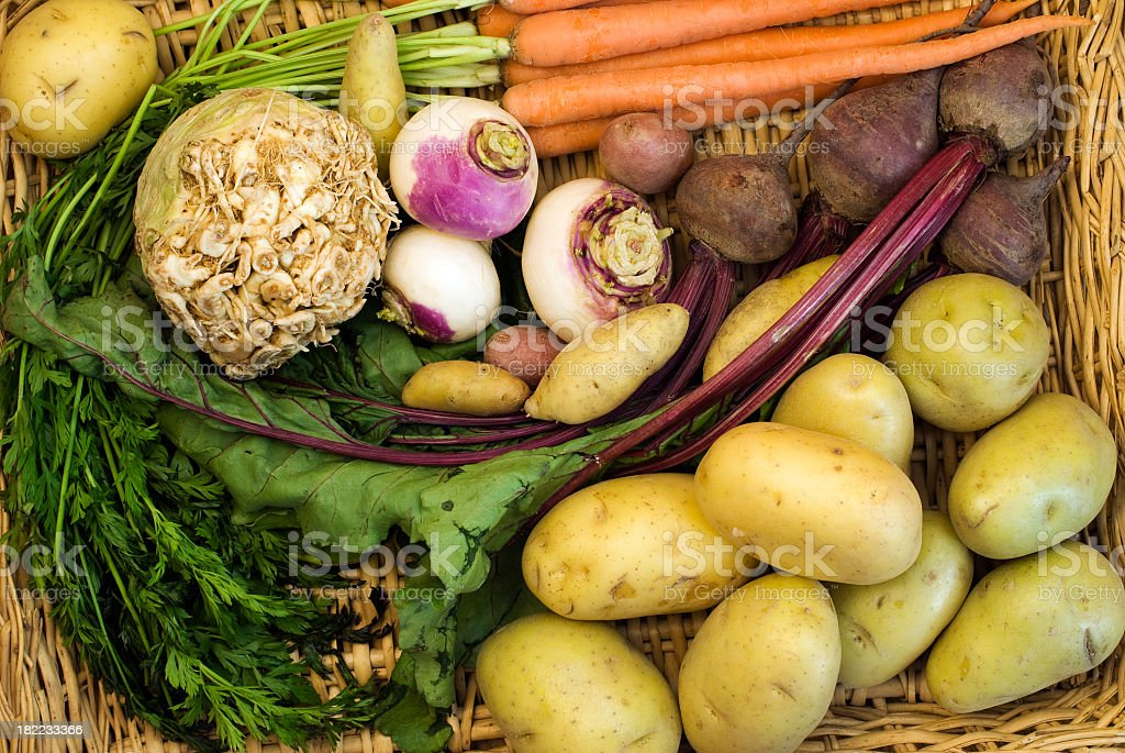 A wicker basket full of root vegetables stock photo