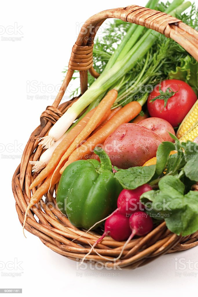 Wicker basket of fresh vegetables royalty-free stock photo