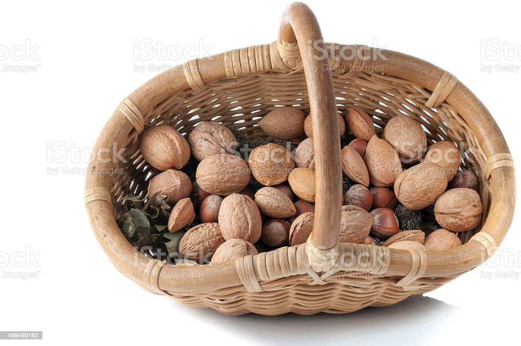 wicker basket with almonds, walnuts and peanuts stock photo