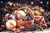 Wicker basket with fir cones, nuts, Christmas balls