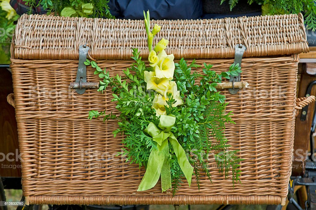 wicker basket with floral decoration stock photo