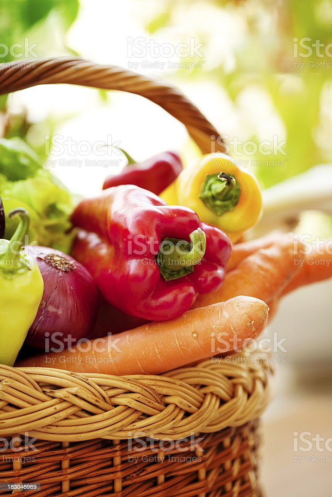 Wicker basket with fresh vegetables royalty-free stock photo