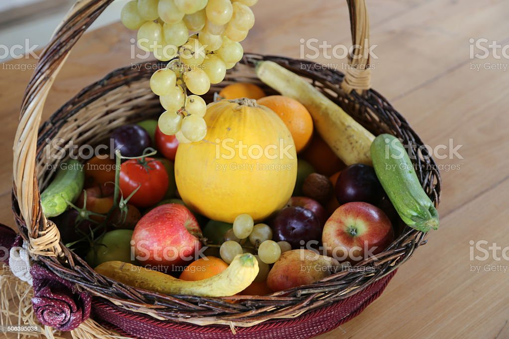 wicker basket with lots of fresh fruit in autumn stock photo