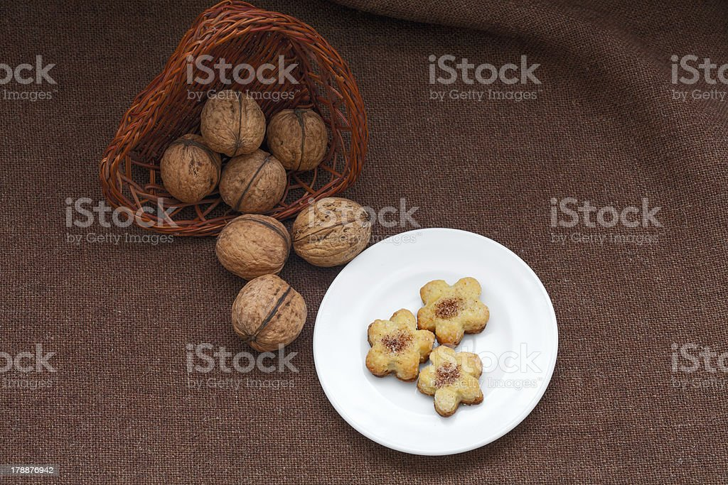 wicker basket with nuts and pastry on a plate royalty-free stock photo