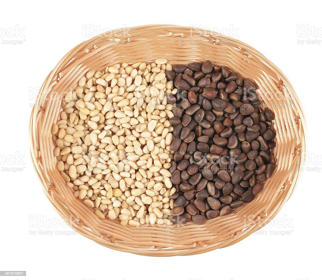 Wicker basket with pine nuts. stock photo