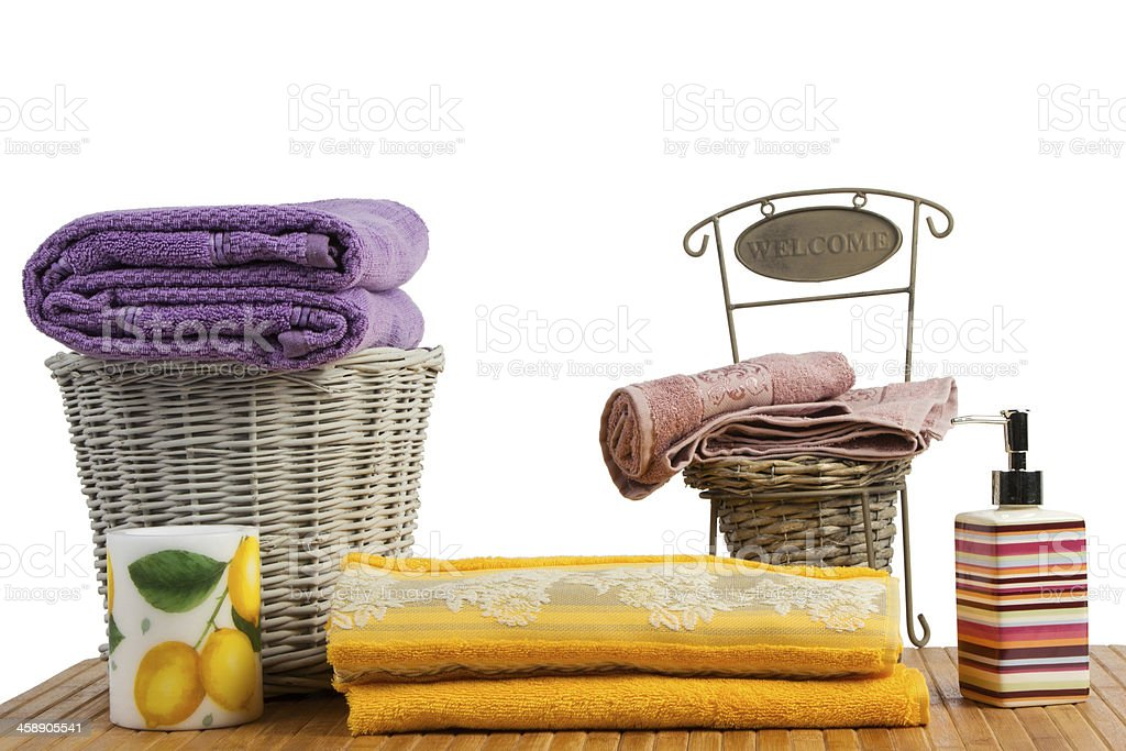 Wicker baskets full of clean colored towels royalty-free stock photo