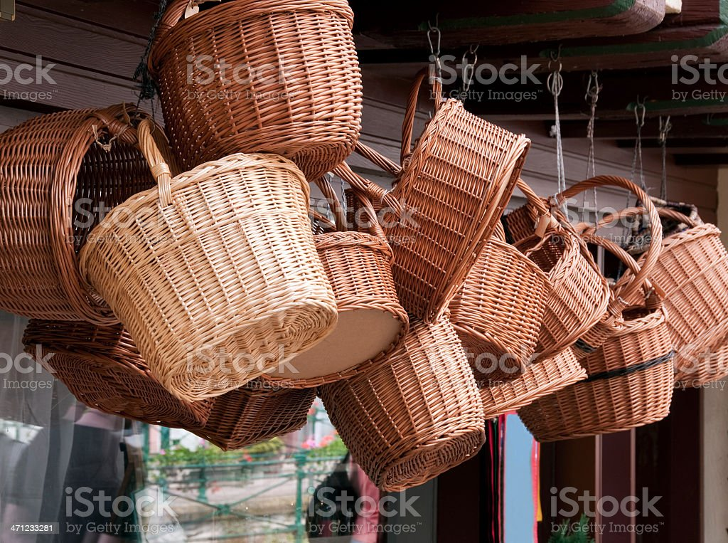 Wicker baskets hanging from ceiling shop window stock photo
