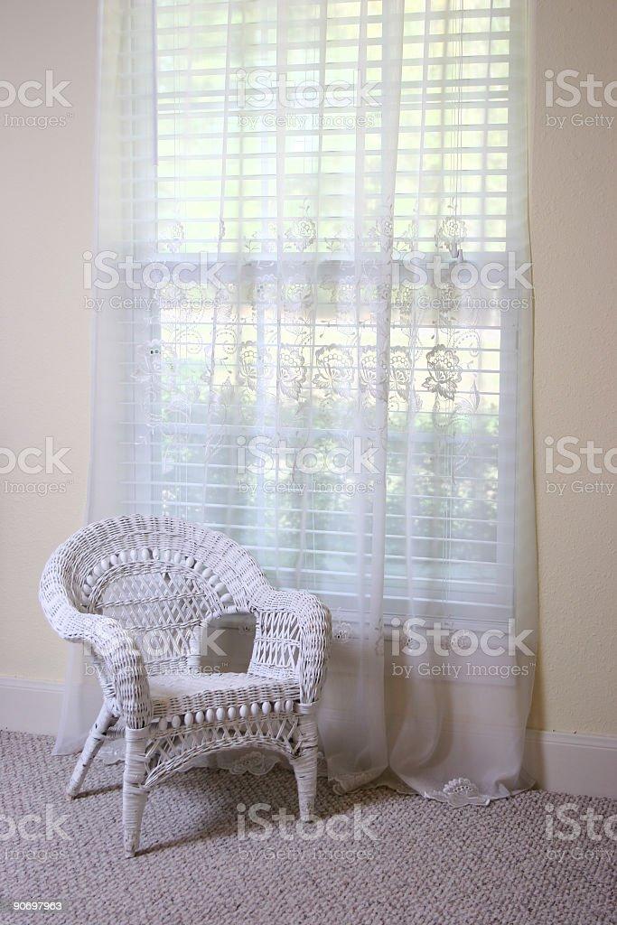 Wicker by window stock photo